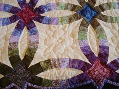 yeah, this one's awesome....like jewel tones on white/cream....Longarm machine quilting - Home Anita Shackelford at Thimble Works