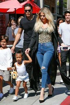 Khloe Kardashian wearing Christian Louboutin So Kate Pumps, Topshop Moto Mid Blue Ripped Jamie Jeans, Baserange Ravenna Leopard-Print Stretch-Bamboo Bodysuit and Naked Wardrobe the Nw Sheer Duster Coat