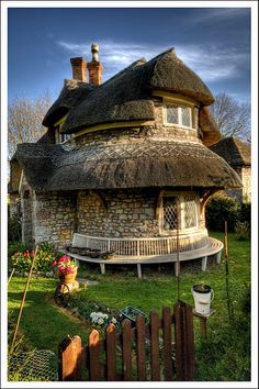 Rubble stone lime mortar thatched cottage in Blaise Hamlet near Bristol, England -- the home is owned by the UK's National Trust. Storybook Homes, Storybook Cottage, Cottage House Designs, Cottage Homes, Fairytale Cottage, Garden Cottage, Victorian House Plans, Victorian Homes, Petits Cottages