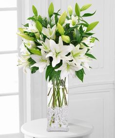 Winter White Lilies: A tall vase of Oriental and Asiatic lilies is on everyone's holiday list. Perfect for winter parties or holiday décor.