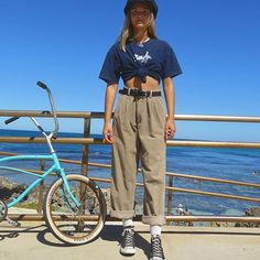 Vintage billabong shirt and vintage corduroy pants with a vintage 60's 'low banana seat fixie'