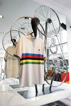 Bicycles used to create displays for cycling jerseys. The merchandise and background follow the same theme.