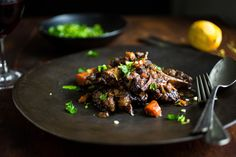NYT Cooking: Don't be scared off by oxtail just because you may never have cooked it before. It's as meaty and rich as short ribs, and just as straightforward to prepare. In this hearty braise, the meat is simmered in wine with carrots and celeriac. Feel free to substitute other vegetables for those roots. For example: mushrooms, celery stalks, turnips, rutabaga, winter squash chunks,%...