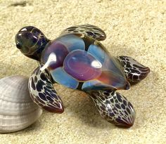 This Amber Seas baby sea turtle pendant is a piece of custom jewelry handmade by myself Ryan Jessee. All of my lampwork glass beads are made with first quality colored borosilicate glass. My artwork is the expression of the beauty I see in nature, and created to be a wearable piece of