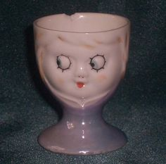 Blue lustre girl face egg cup. Part of the Egg-Centric Collection, Australia