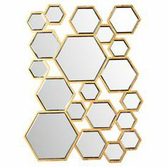 "Showcasing a honeycomb-inspired design, this mirrored wall decor is perfect anchoring a chic frame collage or highlighting your master suite dresser.  Product: Wall mirrorConstruction Material: Wood and mirrored glassColor: Gold frameFeatures: Honeycomb-inspired designDimensions: 31"" H x 22.5"" W x 1"" D"