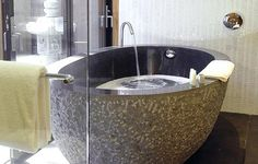 Japanese Ofuro - soaking bath, they are small but tall. Just might fit in our bathroom.