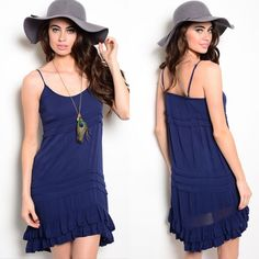 Navy Blue Spaghetti Strap Flowing Ruffle Dress New in retail packaging navy blue spaghetti strap summer dress. Features tiered details all over and has double layer flounced hem. The back is slightly longer than the front. Available in size S.                                                                           100% rayon. Boutique Dresses Mini