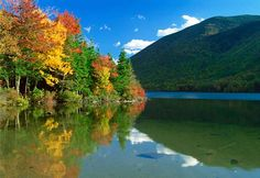 In the White Mountains of northern New Hampshire, visitors can enjoy scenic drives, waterfalls, river gorges and covered bridges in addition to a colorful array of fall foliage.