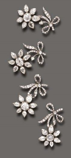 A RARE ANTIQUE SET OF FOUR DIAMOND FLOWER BROOCHES. Each old European and pear-shaped diamond flowerhead, extending an old mine and old European-cut diamond stem, mounted in silver, mid 18th century.