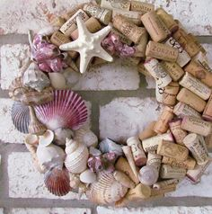 This wine cork wreath is decorated with seashells, all found along the Texas and Florida Gulf Coasts. Three starfish have also been added. This would look great on your front door or in your kitchen or bar area! This wreath is approximately 14 inches outside diameter. If you have your