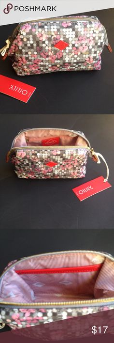 Oilily Soft Frame Pouch NWT NWT cute cosmetics bag. Measures 7 by 5 by 3. Metal frame. 80% polyester ,20%polyurethoan. Inside zipper on one side and pouch on other. Price firm.. Oilily Bags Cosmetic Bags & Cases
