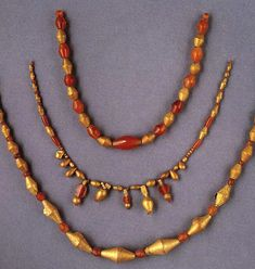 Sumerian Jewellery ~ from the Royal Tombs of Ur | Gold and carnelian beads. The gold beads of this type were made of gold foil wrapped around a bitumen core.