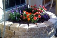 How to Build a Circular Flower Bed With a Stone Retaining Wall | eHow