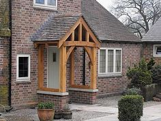 Adding a porch/portico is an opportunity to add interest to your home as well as to gain protection from the weather when entering or exiting your front door. Source by BreiaLee Porch Uk, Front Door Porch, Cottage Porch, Porch Roof, House With Porch, House Front, Front Porches, Cottage Style, Brick Porch