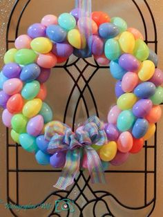 Happy Easter! Celebrate Easter with a fun DIY wreath made from plastic eggs and ribbon! Great idea from Good Housekeeping!