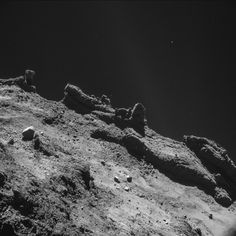 """Philae's photos on Comet. While the images show a range of grays and blacks, the comet is actually """"extremely dark -– blacker than coal,"""" the European Space Agency reports. The images are gray-scaled after being taken to highlight the comet's features."""