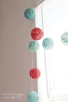 This is such a cute and affordable decor idea! Yarn Ball Window Garland Tutorial