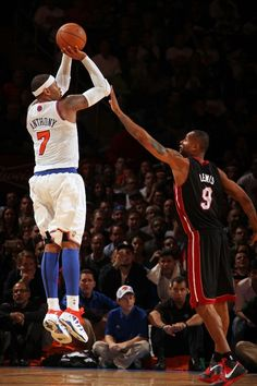 Carmelo Anthony shoots a 3 against Lewis