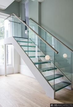 Picturesque Double Chrome Handrail With Glass Balustrade And Landing Glass Stairs In Modern Open Plan Interior Gray Wall Painted Contemporary Designs