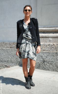 Loose Chanel-style jacket and summer dress with biker accessories.