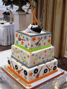 Rock-N-Roll Baby Shower Cake- blue, green, and orange! These are the colors we would use for Liam :)