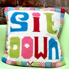 Adorable Jonathan Adler-esque supersized cross stitch pillow DIY!