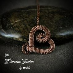 Handmade Copper Pendant and Chain A simple heart of woven wire to grace your sweetheart's dainty neck. ABOUT THIS ITEM • I wove this heart using pure copper wire. • I oxidized, polished and buffed the copper wire to a warm gleaming brown. • Pendant is hung on a delicate antique cop...