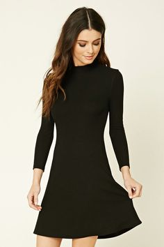 A ribbed knit mini dress featuring a mock neck, long sleeves, and a lightly flared skirt.