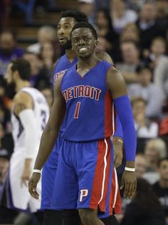 Detroit Pistons guard Reggie Jackson frowns after being