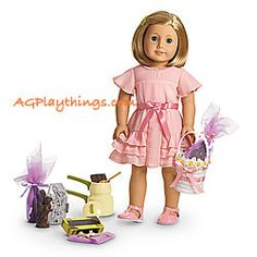"""Kit's Candy-Making Set Item# F9445 $64 This set includes a pretty outfit and sweet supplies: A make-believe double boiler that's perfect for """"melting"""" the two pretend chocolate squares from the candy box. A spoon that Kit can use to mix the chocolate bld. Three faux chocolate bunnies. Three sheets of netting and three satin ribbons to wrap the bunnies. A pretty basket rimmed with fabric flowers to carry the treats. A fancy pink dress for Kit—. Shiny pink T-strap shoes to match her dress."""
