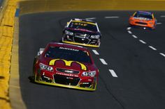 Jamie McMurray, driver of the #1 McDonald's Chevrolet, leads a pack of cars during the NASCAR Sprint Cup Series Bank of America 500 at Charlotte Motor Speedway on October 9, 2016 in Charlotte, North Carolina.
