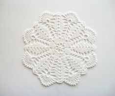 For this white doily I used 100% cotton Markoma thread. I used a 1,65 mm steel hook to crochet it. A traditional heirloom quality little doily created in a traditional soft thread. The doily is 18,5 cm or about 7.3 inches across measured at the largest points. I have washed and