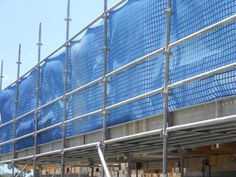 Scaffolding erected around an office block being constructed
