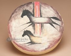 This is a Native American style hand drum made by the Tarahumara Indians, excellent for drumming circles and rustic Native American decor. This single sided hand drum is laced on the back in the patte