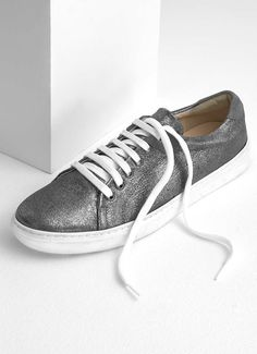 Web Exclusive - These metallic gunmetal trainers are the perfect shoe to wear everyday, featuring a contrasting grey suede and perforated side detail. Available in sizes 3-8. The heel height measures 3.5cm/1.25in.