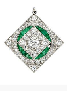 An Art Deco Diamond, Emerald and Platinum Brooch/Pendant, circa 1925 Of symmetrical geometric lozenge design, the square plaque centering a round diamond collet, further decorated with calibre-cut emeralds and round and old European-cut diamonds, with hinged pendant loop, mounted in platinum