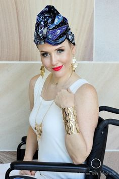 The multi shades of blue in our headwrapMARINE is complimented by a matching gold earring and necklace set, a gold bracelet and bold lipstick.