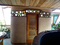 Bottle walls are one of the coolest features of Earthship design. They're literally trash stuck in mud, but they create this beautiful stained-glass effect