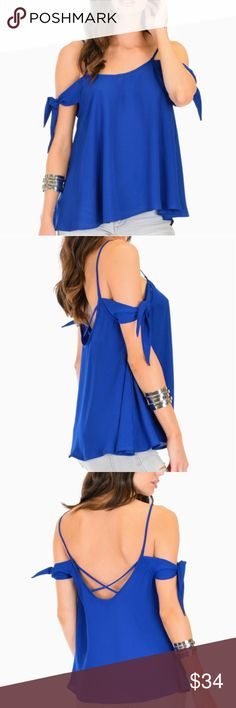 Royal-Tie Strap Top  Royal-Tie Strap Top. Made In: Made in USA Fabric Content: 100% Polyester Sizes: S-M-L-XL Tops