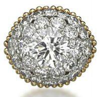 A RETRO DIAMOND COCKTAIL RING, BY VAN CLEEF & ARPELS (Centering upon a brilliant-cut diamond within two rows of diamonds to the fluted wirework hoop, 1950s).