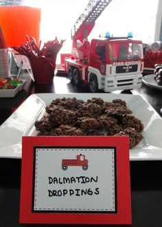 """firetruck party theme food ideas using chocolate cookies as """"dalmation droppings"""""""