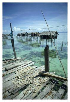 Bajau sea village on stilts in clear ocean