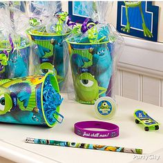 Re-usable plastic party cups?! Cool for favors! Fill 'em up with wristbands, pencils & mini skateboards. Click for more Monsters Inc. party ideas they'll <3