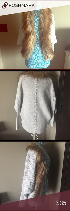 """Fur-trimmed Sweater Boutique purchased NWOT S/M. Oatmeal/cream heathered color with brown hues of fur. Faux-fur trims the neck down both sides of the open cardigan in gorgeous, rounded draping of the front. Bat-wing style arms. Beautiful, high quality knitted fabric of acrylic, nylon, and wool.. """"X"""" pattern down the back to a tie at the bottom. Approx. 28.5 inches from the top of the neck (not the fur) to bottom.  part of the back of the sweater. 😍 *CROSS POSTED* a.gain Sweaters Cardigans"""