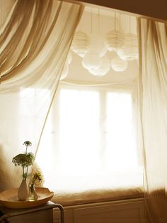 Floaty lights above the bed and breezy curtains. I wonder if @jamesots would like this?