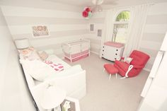 Gray and White Striped Nursery with coral pops of color