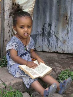 Cute kid reading, Ethiopia.  May she never loose interest in learning.