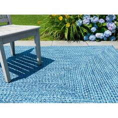 Superb Homespiceu0027s Ultra Durable Indoor Outdoor Sunrose Rug Patterns Pulls  Together The Neutral Tones Of The Chairs And Walls While Accenting The Wood  Conu2026