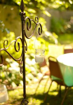 Candles add to the romance of a garden tea party